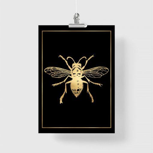 plakat ze złotą muchą