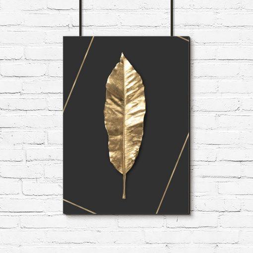plakat ze złotym liściem na czarnym tle
