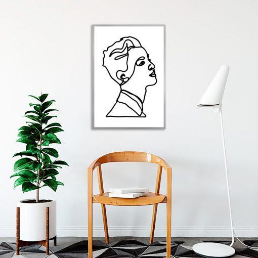kobieta z krótkimi włosami na plakacie