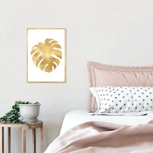 Tropikalny liść w kolorze złota na plakacie