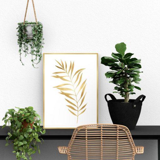 Plakat z liściem w kolorze złota