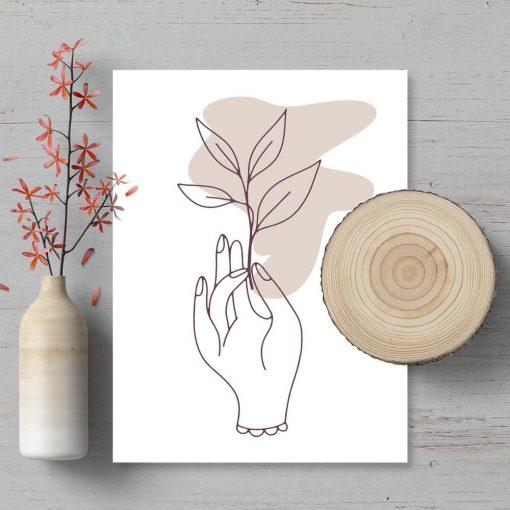 Plakat do sypialni - Dłoń trzymająca gałązkę