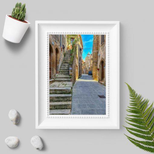 Plakat z architekturą starego miasteczka