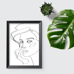 Plakat ze szkicem twarzy kobiety