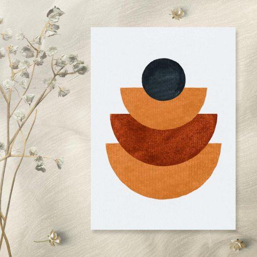 Plakat z czarna kulą nad pomarańczowymi półkolami