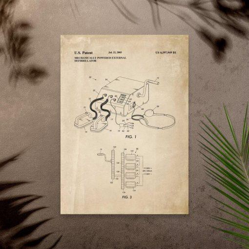 Plakat z kompaktowym defibrylatorem